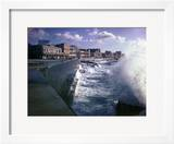 Wave Crashing Against a Breakwater Along the Malecon  a Waterfront Boulevard