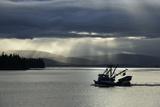 A Fishing Boat Motors Through the Inside Passage Papier Photo par Michael Melford