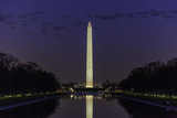 The Washington Monument Seen in the Reflecting Pool at Dusk with a Flock of Geese Papier Photo par Jonathan Irish