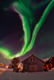 The Aurora Borealis  or Northern Lights  Appear Above a Village