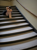 A Ballerina Resting in a Stairwell