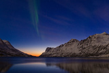 Comet Panstarrs and the Aurora Borealis Appear at Twilight over a Fjord in the Norwegian Sea