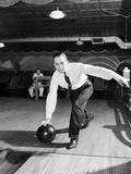 Man Bowling in Tie and Slacks