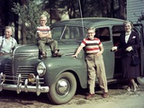A Family Poses on and around their Plymouth Automobile  Ca 1953