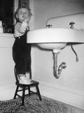 A Young Girl Brushes Her Teeth at the Sink  Ca 1955