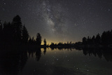Lake at Night with Reflected Stars of the Milky Way and Silhouetted Trees  Lassen Volcanic Np  USA