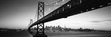 Bridge across a Bay with City Skyline in the Background  Bay Bridge  San Francisco Bay