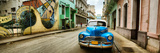 Old Car and a Mural on a Street  Havana  Cuba