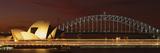 Opera House Lit Up at Night with Light Streaks  Sydney Harbor Bridge  Sydney Opera House