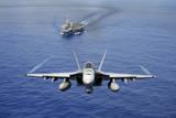 An F-A-18E Super Hornet Flying Above USS John C Stennis
