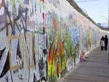 Couple Walking Along the East Side Gallery Berlin Wall Mural  Berlin  Germany  Europe