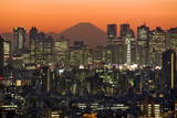 Japan's Highest Peak of Mt Fuji Emerges at Dusk  Seen Through Shinjuku Skyscrapers in Tokyo  Japan