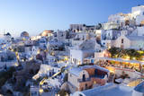 Greece  Santorini  Oia white buildings and steep mountains at sunset