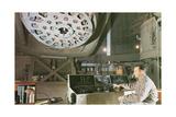 Man at Planetarium Controls