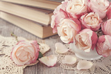 Pink Roses and Old Books on Wooden Desk