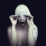 Woman in Bandage over Black Background