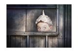 Boy in a Tin Foil Hat Peeking Out of a Window