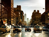 Urban Street Scene with NYC Yellow Taxis and One World Trade Center of Manhattan  Sunset in Winter
