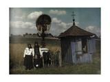 Two Women Stand Beside a Roadside Shrine
