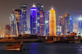 The Colorful Modern Skyline of Doha  on the Persian Gulf  Contrasts with Traditional Fishing Boats