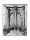 A Photograph of People Standing and Walking on the Brooklyn Bridge Promenade