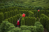 Balloons Drift Away from a Young Woman in the Garden Maze at Luray  Virginia