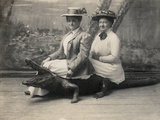 Women Sitting on a Stuffed Alligator  C1905
