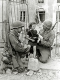 Two American Soldiers from the US Corps of Engineers with a Little Girl and a Puppy