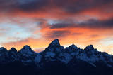 Snowy Peaks in the Teton Range Outlined by an Orange Sky at Sunset