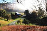 A Farm on a Winding Rural Road on a Foggy Autumn Morning