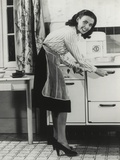 African American Actress Lena Horne at a Gas Stove