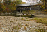 USA  Maine  Bethel Newry Covered Bridge over River in Autumn