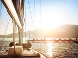 Sailboat on Sunset  Luxurious Water Transport  Bright Sun Light on the Sea  Evening Travel on Sail