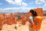 Hiker Woman in Bryce Canyon Hiking Looking and Enjoying View during Her Hike Wearing Hikers Backpac