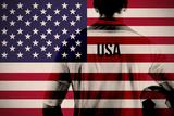 Composite Image of Usa Football Player Holding Ball against Usa National Flag