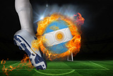 Football Player Kicking Flaming Argentina Flag Ball against Football Pitch and Goal under Spotlight
