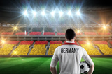 Germany Football Player Holding Ball against Stadium Full of Germany Football Fans