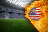 Composite Image of Fire Surrounding Usa Flag Football against Vast Football Stadium with Fans in Bl