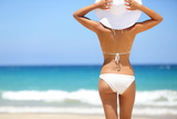 Beach Vacation Hot Beautiful Woman in Sunhat and Bikini Standing with Her Arms Raised to Her Head