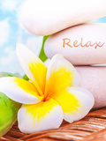Beautiful Spa Still Life on the Beach  Spa Stones  Yellow Frangipani Flower  Tropical Resort  Summe