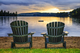 Two Wooden Chairs on Beach of Relaxing Lake at Sunset Algonquin Provincial Park  Canada