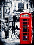 Loving Couple Kissing and Red Telephone Booth - London - UK - England - United Kingdom - Europe