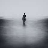 Statue Alone on Beach