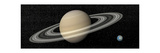 Large Planet Saturn and its Rings Next to Small Planet Earth