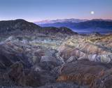 Full moon rising over Zabriskie Point  Death Valley National Park  California