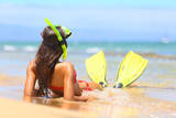 Woman Relaxing on Summer Beach Vacation Holidays Lying in Sand with Snorkeling Mask and Fins Smilin