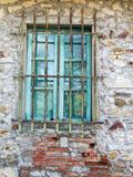 Europe  Italy  Tuscany Turquoise Window on Brick Building