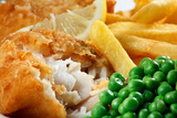 Close up of Fish and Chips with Peas and A Slice of Lemon