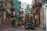Street Scene before Sunrise - Dilapidated Buildings Crowded Together and Vintage American Cars