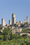 View across Field to Typical Houses and Medieval Towers  San Gimignano  Siena